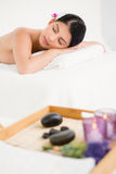 Pretty woman lying on the massage table Stock Photography