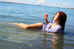 Woman in sea royalty free stock photo