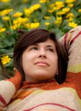 Pretty Woman Lying In Yellow Flowers Royalty Free Stock Photos