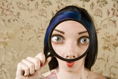 Pretty Woman with a Magnifying Glass in front of h Royalty Free Stock Images