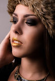 Pretty Woman with Make up Wearing Furry Hat Stock Images