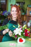 Pretty Woman Making Arrangement in Flower Shop Stock Photography