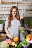 Pretty woman making detox juice Royalty Free Stock Images