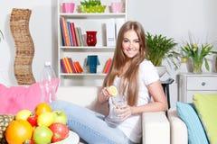 Pretty woman making detox water Stock Image