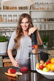 Pretty woman making fresh detox juice Stock Images