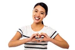 Pretty woman making heart symbol with hands Royalty Free Stock Photo
