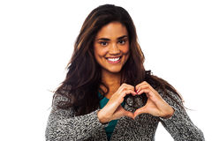 Pretty woman making heart symbol with hands Stock Photo