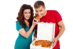 Pretty Woman Making Her Boyfriend End Pizza Piece Royalty Free Stock Photos