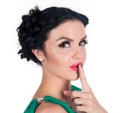 Pretty woman making a keep it quiet gesture Royalty Free Stock Images