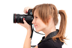 Pretty woman making photograph. Side view Royalty Free Stock Photo