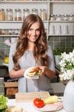Pretty woman making sandwich Royalty Free Stock Photos