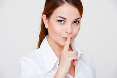 Pretty woman making silence sign Stock Photo
