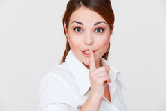 Pretty woman making silence sign. Over grey background Royalty Free Stock Image