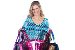 Pretty woman with many colorful shopping bags Royalty Free Stock Image