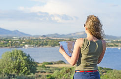 Pretty woman with map Stock Images