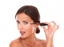 Pretty woman with mascara showing her femininity Stock Image