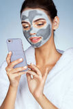 Pretty woman with mask of clay on her face Royalty Free Stock Photography