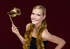 Pretty woman with masquerade mask and tinsel Royalty Free Stock Image