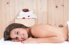 Pretty woman in a massage center with towel Royalty Free Stock Photography