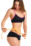 Pretty woman measuring perfect shape of beautiful waist Stock Image