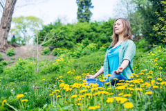 Pretty woman meditate in the park Stock Photography