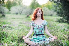 Pretty woman meditate in the park Royalty Free Stock Images