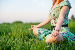 Pretty woman meditate in the park Stock Photos