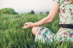 Pretty woman meditate in the park Stock Images