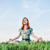 Pretty woman meditate in the park Royalty Free Stock Image