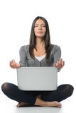 Pretty Woman Meditating with Laptop. Pretty Long Hair Woman in Meditating Pose with Closed Eyes and Crossed Legs While Facing a Laptop in Front. Isolated on Stock Images