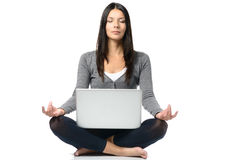 Pretty Woman Meditating with Laptop Stock Image