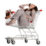 Pretty woman mobile phone speaking. Pretty brunette woman phone speaking in empty shopping trolley, isolated on white background Royalty Free Stock Photo