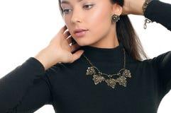 Pretty woman model demonstrated luxury jewelry. Studio portrait Royalty Free Stock Photos