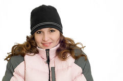 Pretty Woman Model Wearing Pink Winter Ski Coat. Pretty Redhead Woman Wearing Pink Winter Down Ski Coat and black hat isolated on solid white background Stock Photos