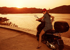 Pretty woman on motorcycle Royalty Free Stock Photos