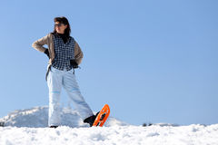 Pretty woman in the mountains in winter Royalty Free Stock Photos