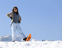 Pretty woman in the mountains in winter Royalty Free Stock Images