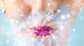 Pretty woman mouth blowing cold breeze Royalty Free Stock Photo