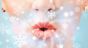 Pretty woman mouth blowing cold breeze royalty free stock images
