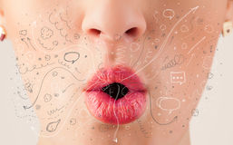 Pretty woman mouth blowing hand drawn icons and symbols stock photo
