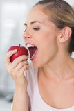 Pretty woman munching apple in close up Stock Photos