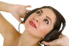 Pretty woman and music Royalty Free Stock Photos