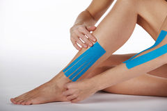 Pretty woman naked with sports taping on the body Stock Photography