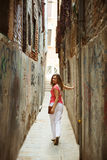 Pretty woman in narrow Venice street Stock Image
