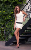 Pretty woman near the metal stairs Stock Images