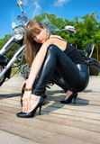 A pretty woman near by motorcycle Stock Photography