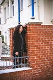 Pretty woman near orange brick wall Royalty Free Stock Photo
