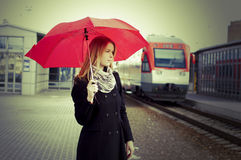 Pretty woman near the train travelling in station Royalty Free Stock Photo