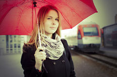 Pretty woman near the train travelling in station Royalty Free Stock Photography