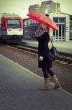Pretty woman near the train travelling in station Royalty Free Stock Photos